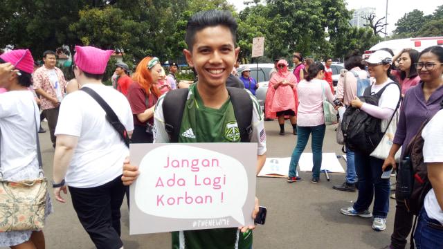 Poster dalam aksi Women's March.