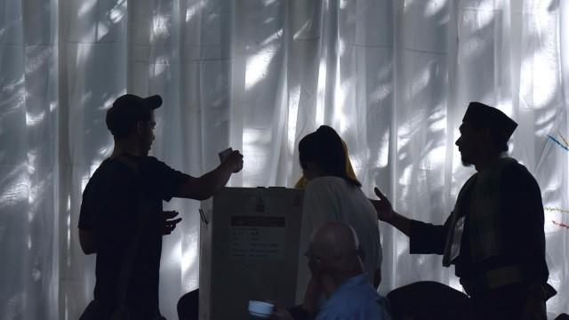 Ilustrasi pemungutan suara di TPS