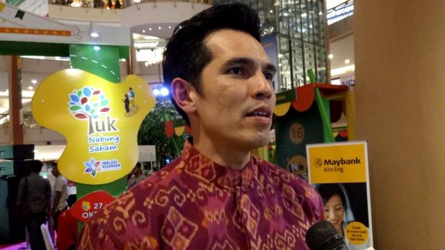 Adrian Maulana, menghadiri acara Investival 2017