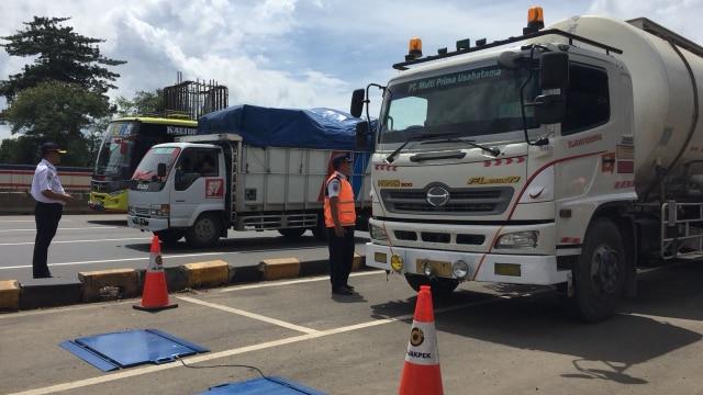 Pengukuran berat muatan truk