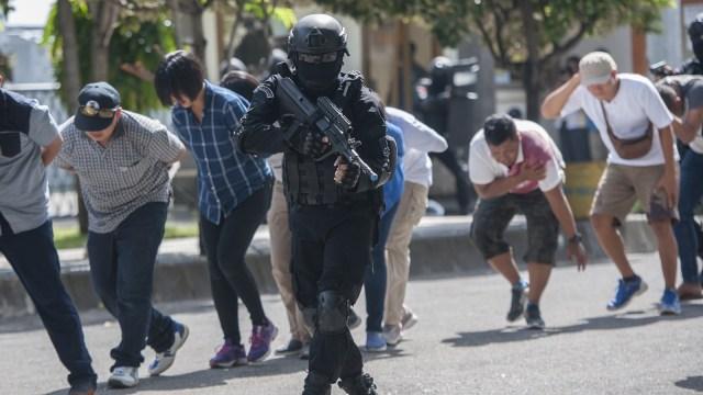 Jokowi Terbitkan PP, Korban Terorisme Masa Lalu Bisa Ajukan Kompensasi ke Negara (1165640)