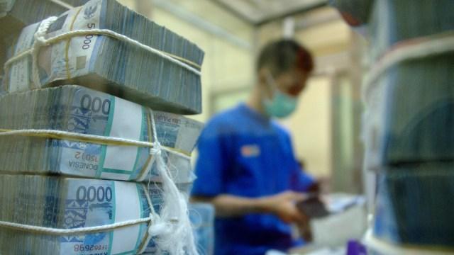 Ilustrasi umpukan uang Rupiah.
