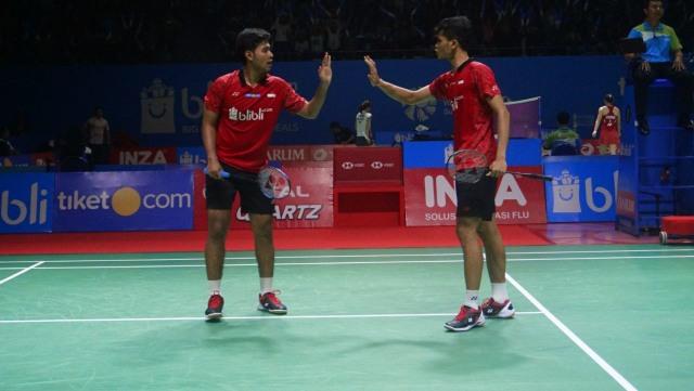 Pebulu tangkis Indonesia Ricky Karandasuwardi dan Angga Pratama pada Turnamen Bulu Tangkis Blibli Indonesian Open 2018