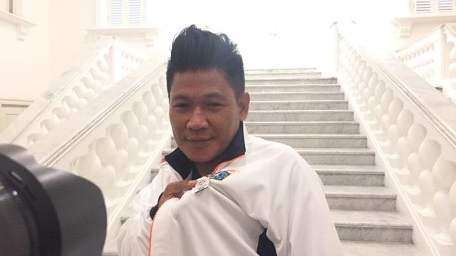 Tamran, Warga yang memasang bendera negara  peserta asian games
