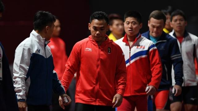 Lifter Indonesia Eko Yuli saat pertandingan angkat besi kategori 62 kg.
