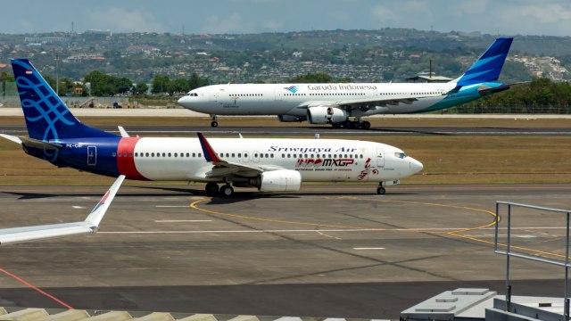 Ilustrasi Maskapai Garuda dan Sriwijaya Air