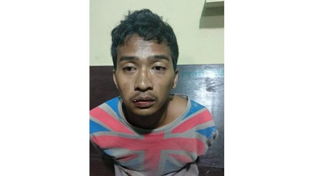 Herman (25), terduga pembunuh Levie Prisilia ditangkap polisi.