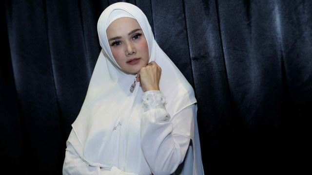 Krisdayanti dan Mulan Jameela, Penyanyi yang Terpilih Jadi Anggota DPR (731821)