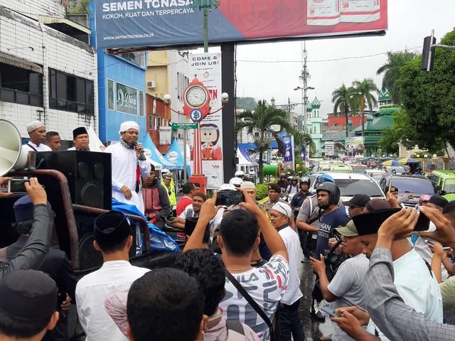 Pendemo di Ambon Minta Kemenangan Jokowi-Ma'ruf Dibatalkan  (244896)