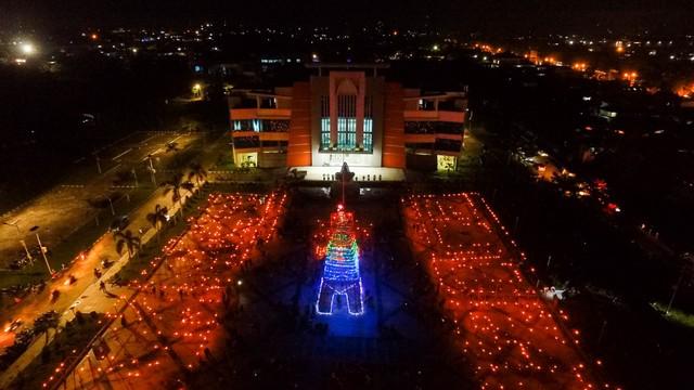 Merawat Tradisi Tumbilotohe lewat Miniatur Menara Pakaya Limboto (400975)