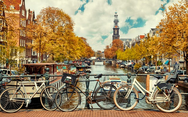 com-Belanda