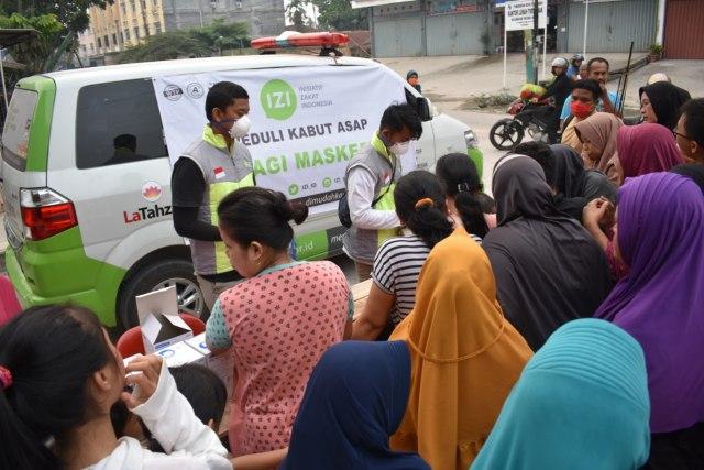 Bahaya Kabut Asap, Kami Bagikan Masker N95 untuk Warga Riau (248194)