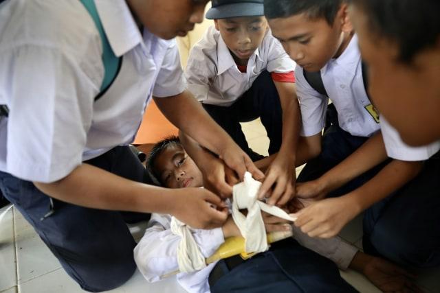 Foto: Siswa di Daerah Bekas Tsunami Aceh, Belajar Siaga Bencana (2652)