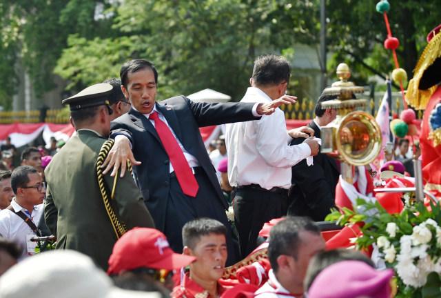 Beda Cara Relawan Rayakan Pelantikan Jokowi di 2014 dan 2019 (47273)