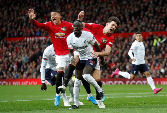 Pertandingan Manchester United vs Liverpool di Old Trafford, Manchester, Inggris