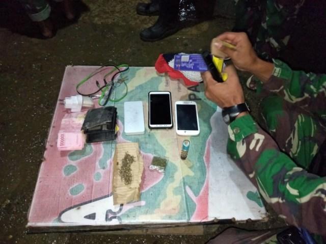 TNI Amankan Dua Orang di Perbatasan RI-PNG  (515428)