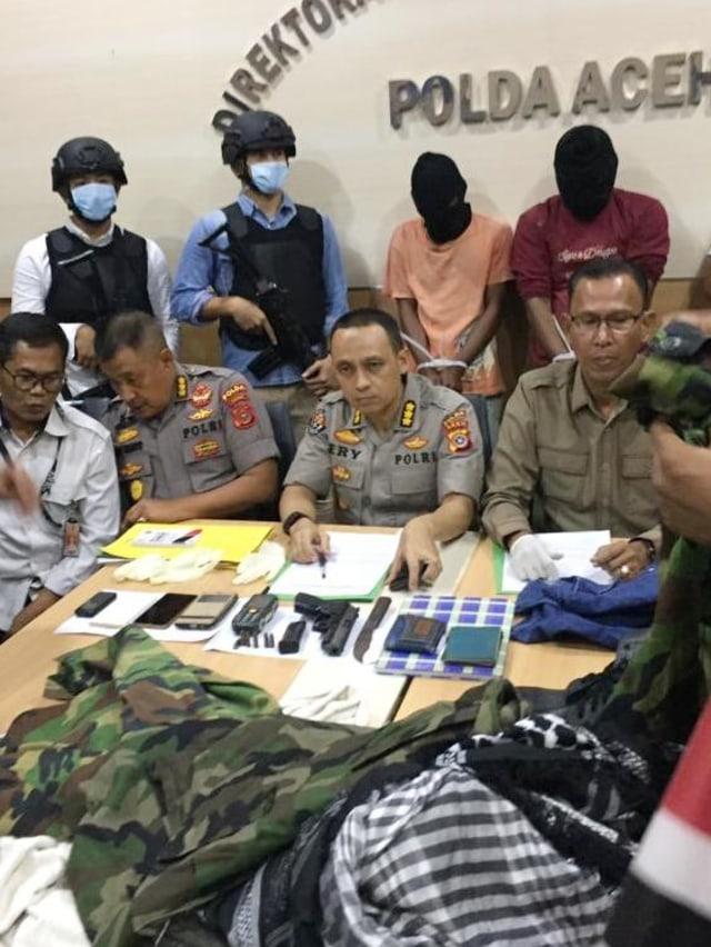 Polisi Buru 4 Anggota Bangsa Aceh Darussalam (13009)