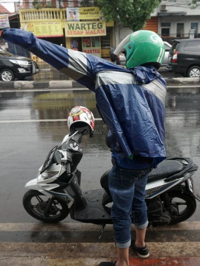 Pemotor, Jangan Paksakan Diri untuk Berkendara dalam Kondisi Hujan  (252070)
