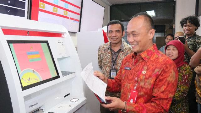 Dukcapil Kenalkan Mesin ADM, Warga Bisa Cetak Sendiri e-KTP hingga KK (308663)