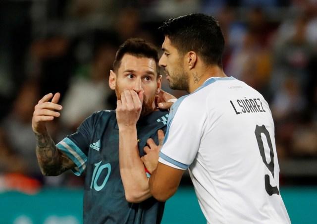 Suarez dan Messi.