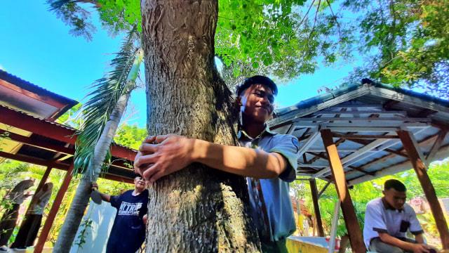 Memeluk Pohon: Merayakan Hari Pohon Sedunia ala Gorontalo (64900)