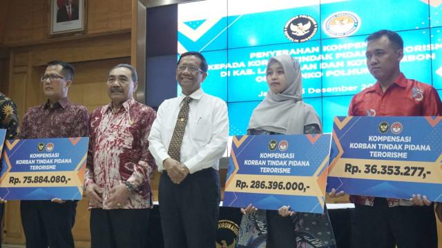 Jokowi Terbitkan PP, Korban Terorisme Masa Lalu Bisa Ajukan Kompensasi ke Negara (1165637)