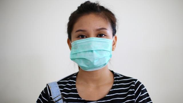 Peringatan Pemerintah: Jangan Sangkutkan Masker ke Dagu, Kuman Berpindah (294993)