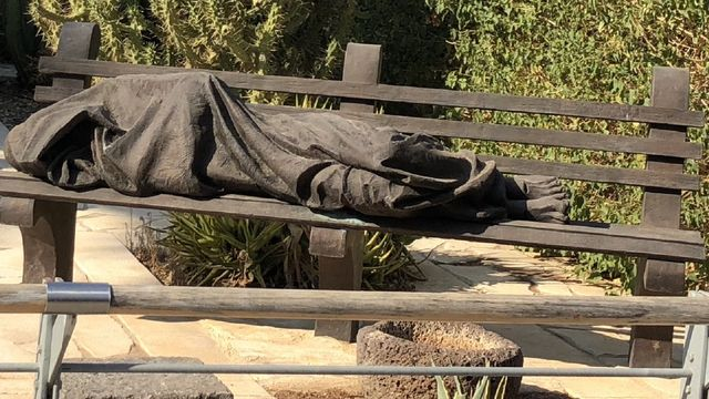 Statue_of_Jesus_as_a_Homeless_Man_in_Roman_Catholic_Capharnaum.jpg
