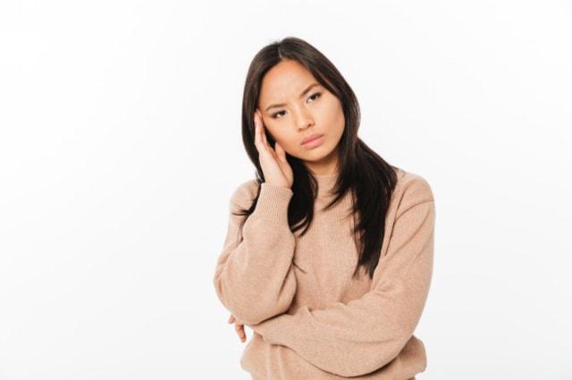 sad-lady-with-headache-standing-isolated_171337-2125.jpg
