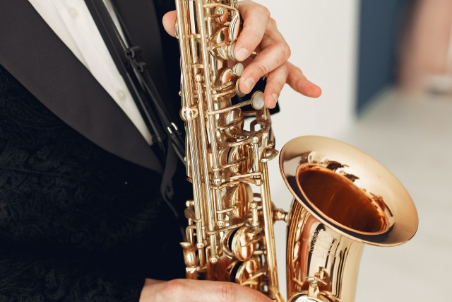 person-holding-brass-saxophone-3984800.jpg