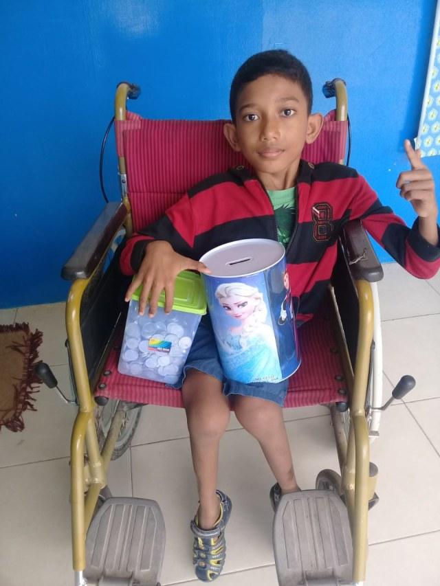 Seorang Bocah Disabilitas di Batam Bongkar Celengan untuk Bantu Tim Medis (254021)