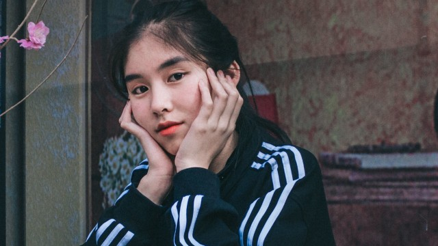 woman-in-black-and-white-adidas-jacket-holding-her-cheeks-3698750 (1).jpg