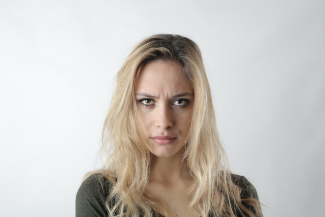 portrait-photo-of-woman-frowning-3785839(1).jpg