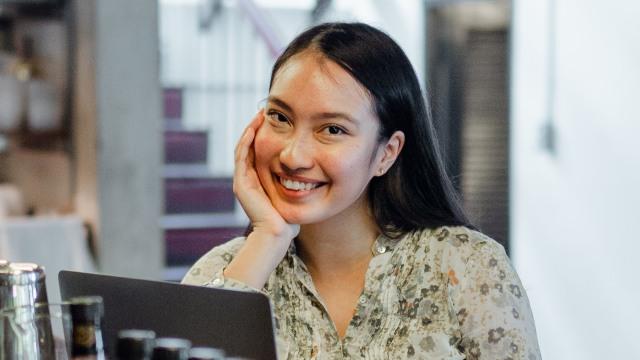 joyful-young-asian-female-relaxing-in-bar-4350180 (1).jpg