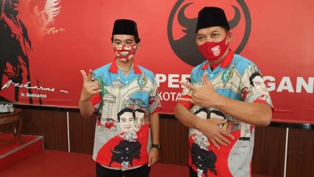 Gibran-Teguh Pamer Baju Kampanye Pilwalkot Solo: Bergambar Naik Banteng (751654)