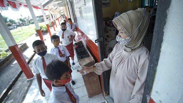 Foto: Aktivitas Siswa SD di Sumsel setelah Diizinkan Kembali Sekolah  (128243)