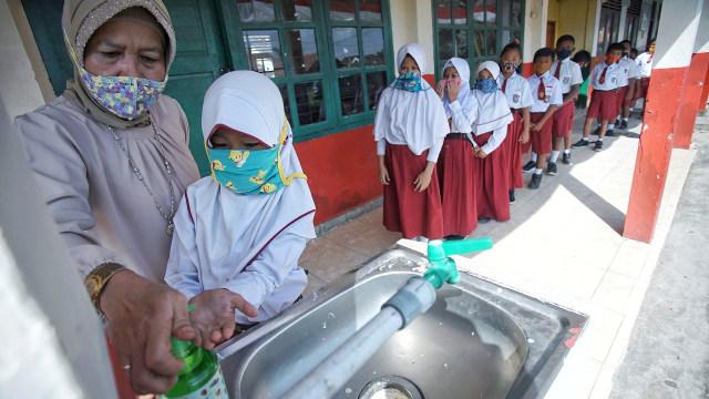 Foto: Aktivitas Siswa SD di Sumsel setelah Diizinkan Kembali Sekolah  (128244)