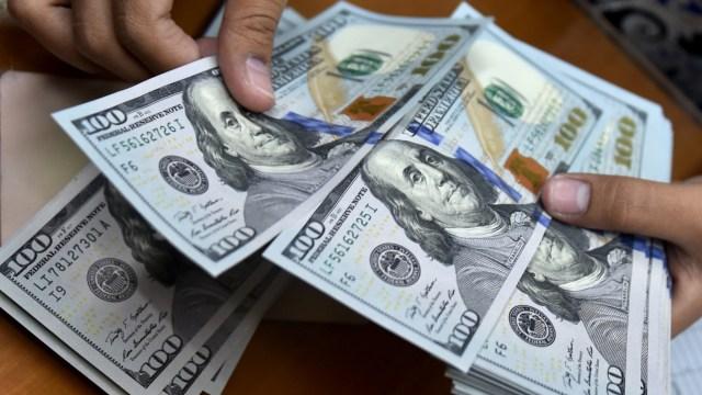 Bukan Uang Mainan, Dolar Bergambar Wajah Santa Klause Ini Legal di AS (276741)