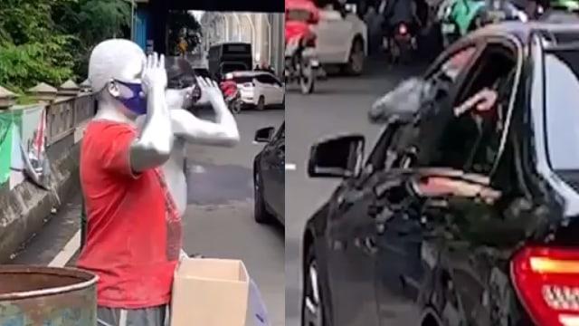 Momen Manusia Silver Tegur Pengemudi Mobil yang Buang Sampah Sembarangan (32672)