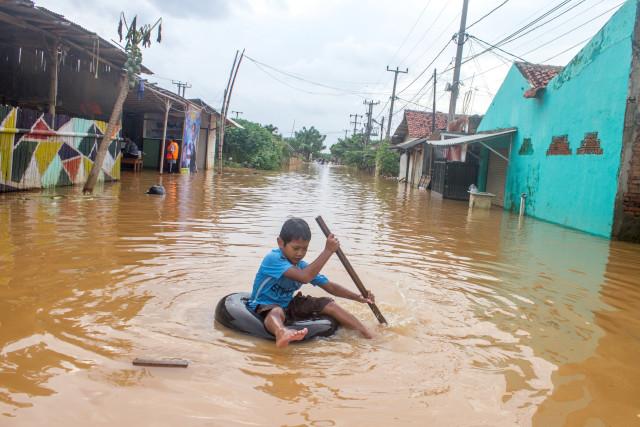 Cara Cegah Anak Jadi Korban Jiwa saat Banjir (31627)