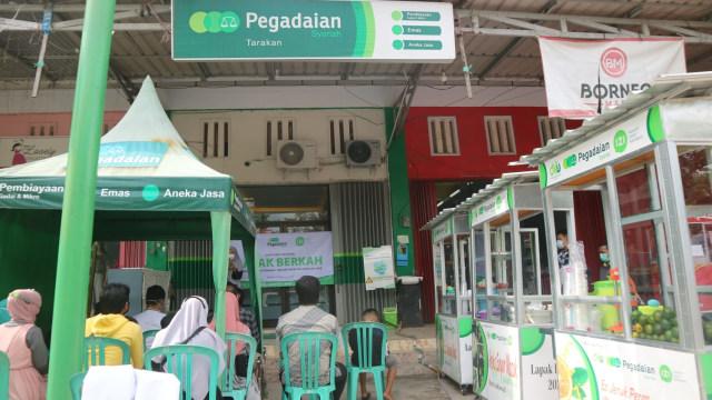 Pegadaian Syariah Tarakan dan Inisiatif Zakat Indonesia Bantu Pedagang UMKM  (93235)
