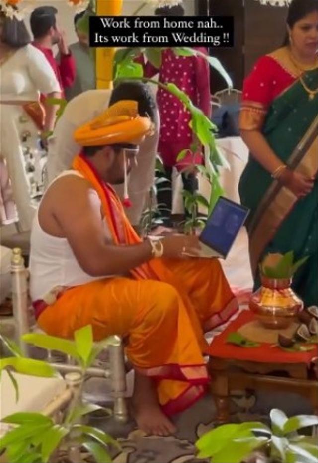 Workaholic, Pengantin Pria Ini Malah Sibuk dengan Laptop di Hari Pernikahannya (463408)
