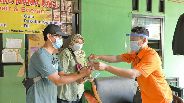 95% Bantuan Sosial Tunai di DKI Jakarta Sudah Disalurkan oleh Pos Indonesia (173538)