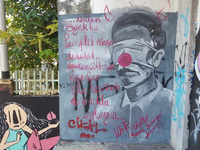 Mural Mirip Presiden Jokowi dengan Kepala Bertanduk di Pangkalpinang (229216)